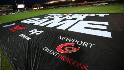 Ahead of the Dragons versus Blues Boxing Day derby, rugby fans lay a banner across Rodney Parade in protest against the power struggles that have thrown the game into turmoil