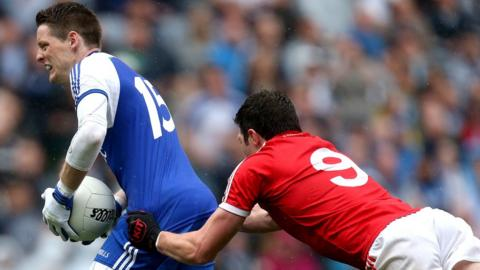 Sean Cavanagh's controversial foul prevents Monaghan's Conor McManus for taking a shot at goal in the closing stages of the All-Ireland Football quarter-final won 0-14 to 0-12 by the Red Hands