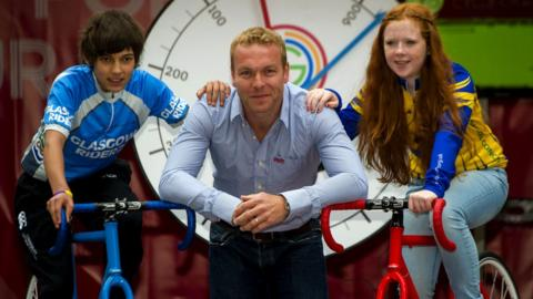 Chris Hoy with two young cyclists