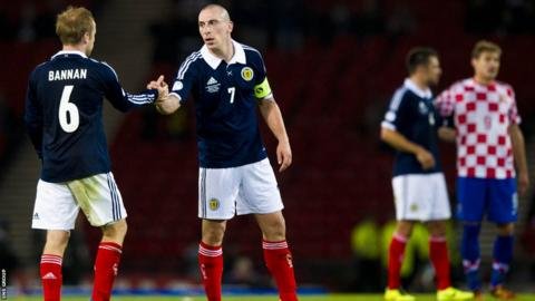 Scotland captain Scott Brown shakes hands with Barry Bannan