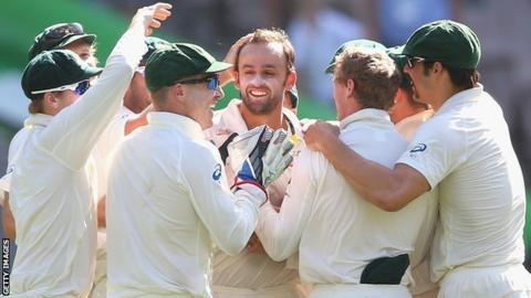 Nathan Lyon is congratulated by his Australia team-mates
