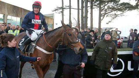 Barry Geraghty on board Bobs Worth is led into the parade ring after winning The Lexus Steeplechase