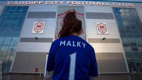 A Cardiff City supporter outside the stadium after manager Malky Mackay was sacked on Friday.