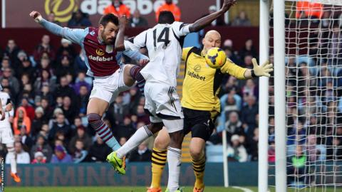 Swansea's Roland Lamah scores the equaliser in the 1-1 draw with Aston Villa at Villa Park.