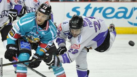 Darryl Lloyd of the Belfast Giants in action against Chris Frank of the Breahead Clan