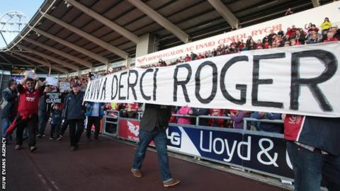 Regional rugby fans protest against the WRU before the Scarlets-Ospreys game on Boxing Day