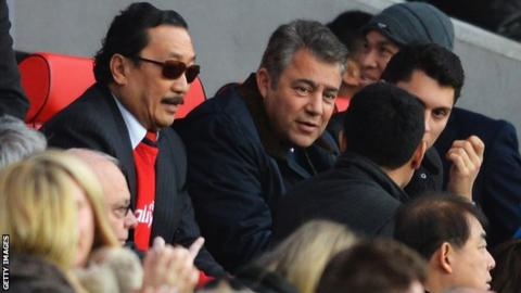 Cardiff City owner Vincent Tan (L) and chairman Mehmet Dalman (C)