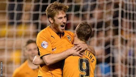 Wolves winger James Henry celebrates with Leigh Griffiths