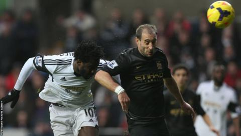 Swansea's Wilfried Bony (left) heads home his side equaliser to make it 1-1 against Manchester City