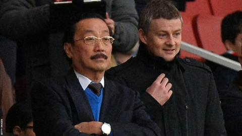 Cardiff owner Vincent Tan (left) and the club's prospective new manager Ole Gunnar Solskjaer watch the Bluebirds take on Arsenal in the Premier League