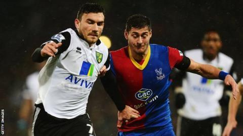 Norwich midfielder Robert Snodgrass battles with Crystal Palace defender Joel Ward