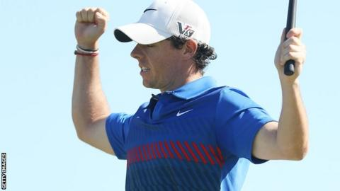 Rory McIlroy celebrates winning the Australian Open