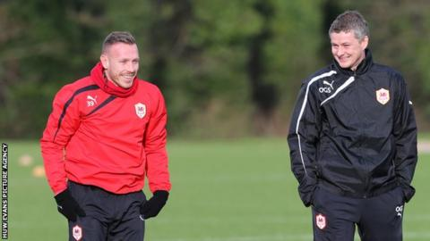 Cardiff City's Craig Bellamy and new manager Ole Gunnar Solskjaer