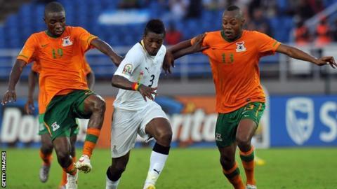 Zambia's Nathan Sinkala (left) and Stoppila Sunzu (right) tackle Ghana's Asamoah Gyan (centre)