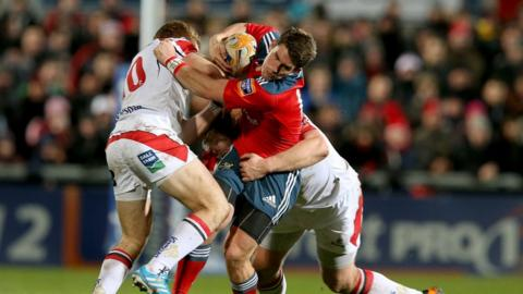 Ulster's Paddy Jackson and Tom Court combine to tackle Munster fly-half Ian Keatley