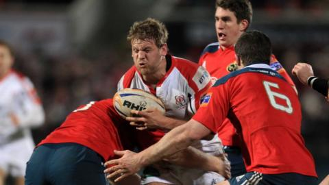 Ulster flanker Chris Henry is tackled by Munster duo Stephen Archer and Peter O'Mahony