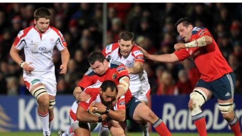 Kiwi prop John Afoa attempts to make ground for Ulster despite the attention of Damien Varley