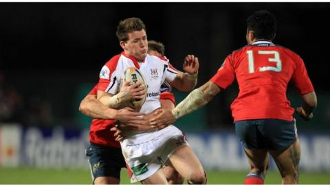 Ulster winger Craig Gilroy finds his progress halted by Dave Foley and Casey Laulala