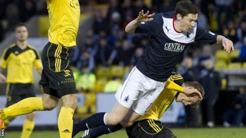 Falkirk's Conor McGrandles is brought down by Coll Donaldson