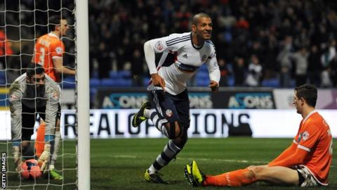 Bolton striker Jermaine Beckford celebrates scoring Bolton's winner against Blackpool