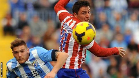 Atletico Madrid beat Malaga to move top of La Liga