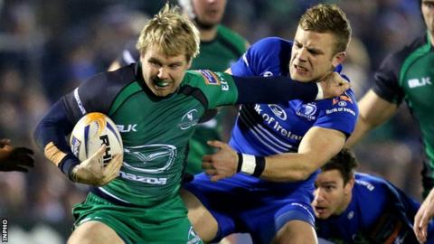 Connacht try-scorer Fionn Carr attempt to fend off Ian Madigan