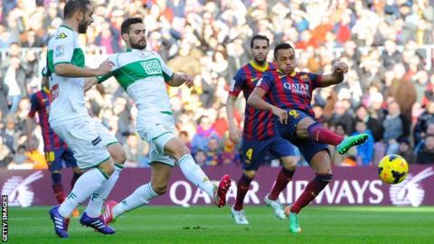 Alexis Sanchez scores three goals as Barcelona beat Elche to go top of La Liga.