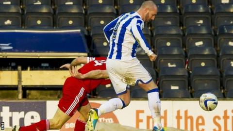 Russell Anderson is challenged by Kris Boyd