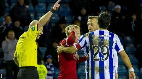 Referee Craig Charleston sends off Nicky Low