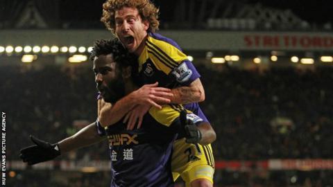 Swansea City's Wilfried Bony celebrates with Jose Canas