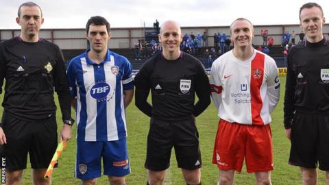 Coleraine's captain Michael Hegarty stands beside his brother Gavin (left) who was linesman at the game against Ards