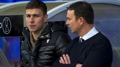 Filip Kiss and Ross County manager Derek Adams
