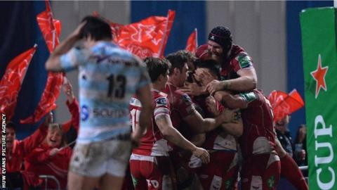 Scarlets players celebrate Kristian Phillips' try against Racing Metro