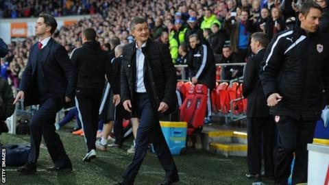 Ole Gunnar Solskjaer walks out for the first time at Cardiff City Stadium as manager