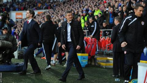 New manager Ole Gunnar Solskjaer walks out in front of the Cardiff City Stadium crowd for the first time as he takes charge for the Premier League game with West Ham United