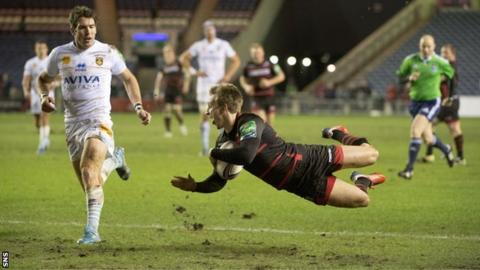 Tom Brown flies over the line to complete his try for Edinburgh.