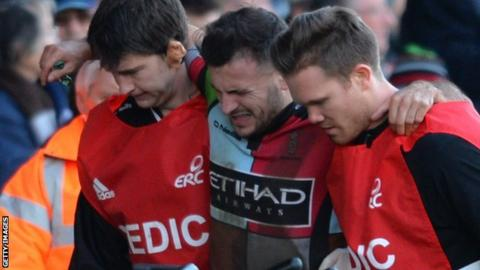 Danny Care is helped off the pitch