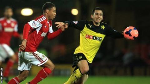 Bobby Reid of Bristol City and Cristian Battocchio of Watford