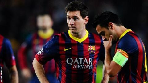 Barcelona Forward Lionel Messi L And Midfielder Xavi