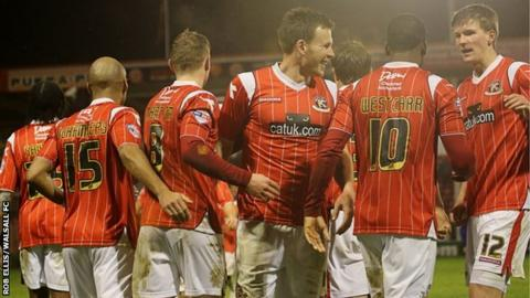 Walsall's player celebrate their midweek matchwinner against Oldham