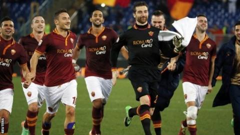 Roma's Francesco Totti (third left) celebrates with his teammates after winning their Italian Serie A soccer match against Livorno