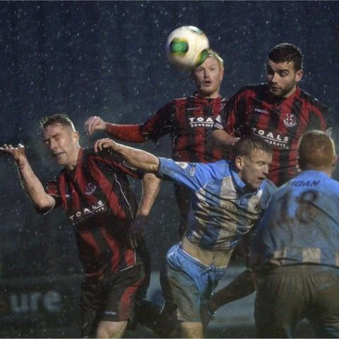 Warrenpoint Town and Crusaders battled out a 1-1 in tough conditions at Milltown