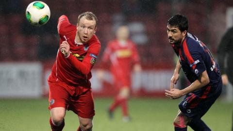 Cliftonville striker Liam Boyce looks favourite to get to the ball ahead of Portadown defender Emmett Friars at Solitude