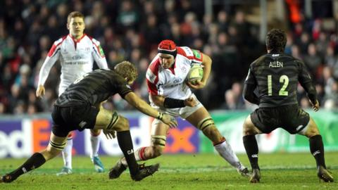 Johann Muller prepares to drive into Leicester's Jamie Gibson as Ulster secure a home Heineken Cup quarter-final