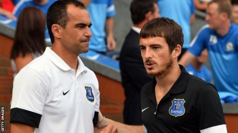 Everton manager Roberto Martinez (left) and left-back Leighton Baines