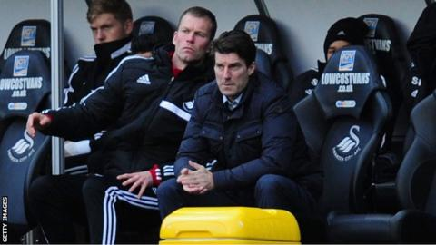 Michael Laudrup looks on from the dugout as Swansea lose at home to Tottenham