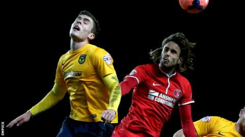 Oxford United's Josh Ruffels and Charlton Athletic's Diego Poyet (right) battle for the ball