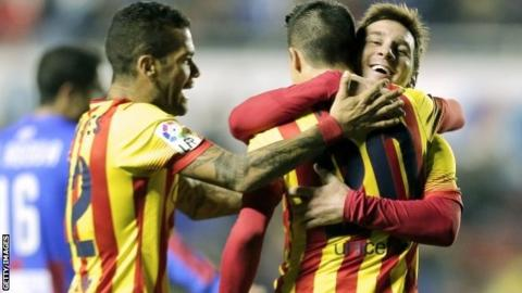 "Barcelona's forward Cristian Tello (second right) celebrates his third goal with Barcelona""s Argentine forward Lionel Messi (right)"
