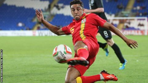 Neil Taylor in action for Wales
