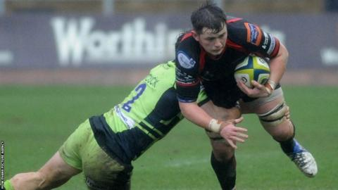 Northampton's Mike Haywood tackles Newport Gwent Dragons back-row James Benjamin in the LV= Cup clash at Rodney Parade.